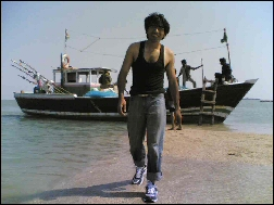Raheel getting off the boat