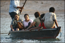 Madhavi & Avina riding the canoe